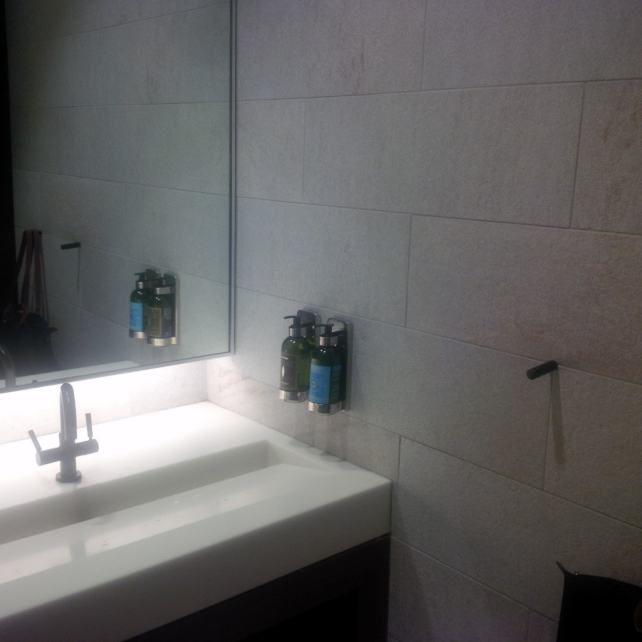 "The bathroom with L'Occitane products - ""The Centurion Lounge - Making the Best of a Long Layover"" - Two Traveling Texans"