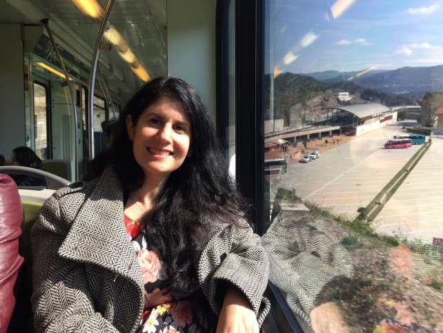 "Anisa on the train, ready to head up. - ""Montserrat: Mountain, Monastery, and Wine"" - Two Traveling Texans"