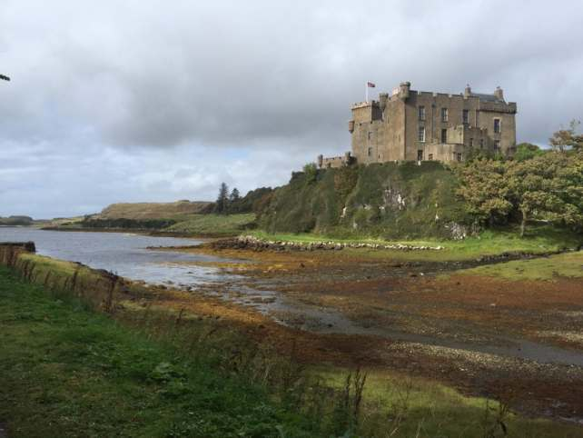 Dunvegan Castle is built on a hill over looking the water.