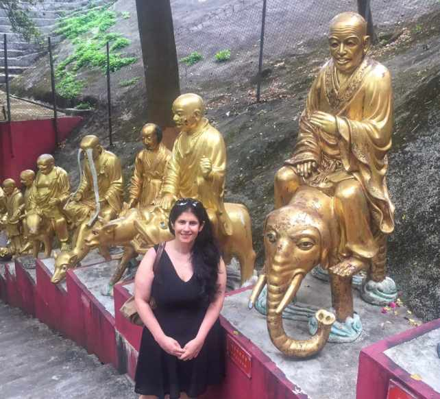 """Anisa and a few Buddhas.... - """"The Truth about the 10000 Buddhas Monastery"""" - Two Traveling Texans"""