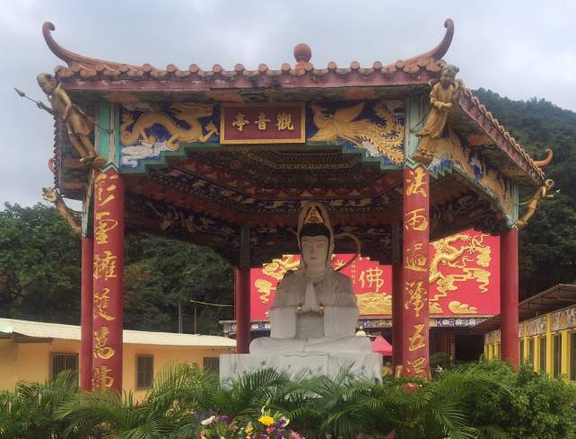 """One of the Buddhas by the main temple. - """"The Truth about the 10000 Buddhas Monastery"""" - Two Traveling Texans"""
