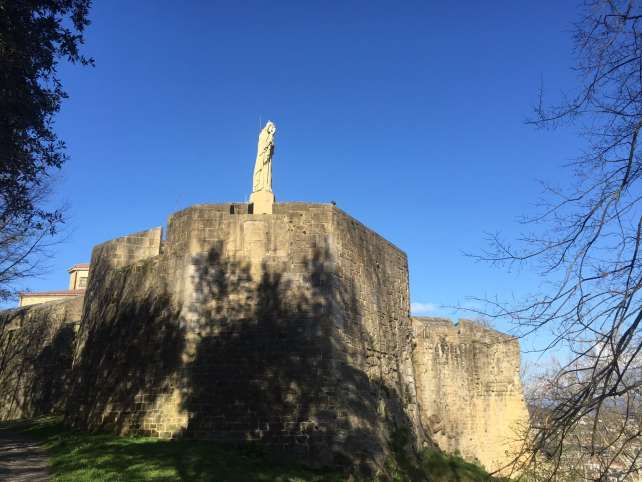 The statue of Christ on top of the castle.