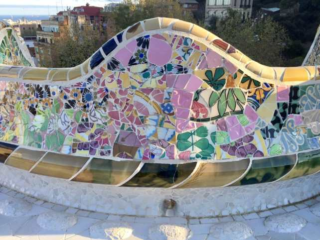 "I was really impressed by the colorful mosaics in Park Guell. - ""Why I Fell in Love With Gaudi in Barcelona"" - Two Traveling Texans"