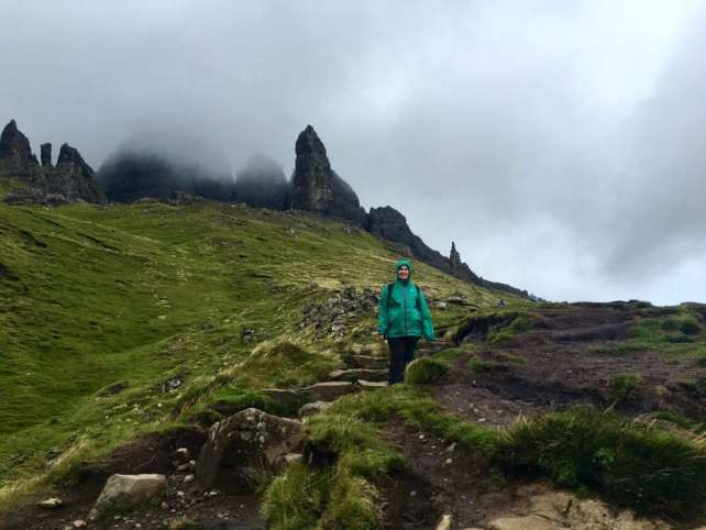 "Anisa climbing the steps towards the Old Man of Storr. - ""Old Man of Storr: Hiking in the Clouds"" - Two Traveling Texans"