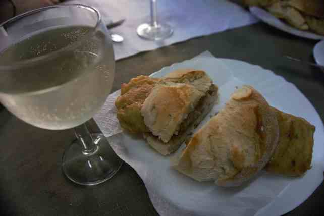 """The salted cod sandwich with a glass (or two) of Vinho Verde. -""""Porto Food Tour: Taste the Local Specialties"""" - Two Traveling Texans"""