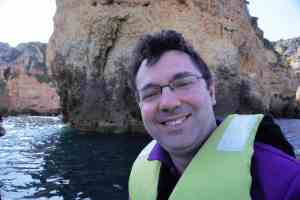 "Russell on the smaller boat as we headed to the caves. - ""Algarve Caves By Boat with Bom Dia"" - Two Traveling Texans"
