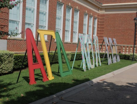Colorful and decorated Greek life organization letters stand proud in front of Hubbard Hall. (Photo by Chuck Greenslade)