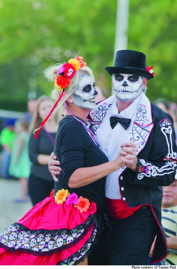Community members dance together during last year's Day of the Dead festival.