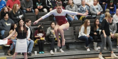 Gymnast Schyler Jones performs on the beam at the 2016 USA Gymnastics Collegiate National Championship, where she earned three All-Around honors.