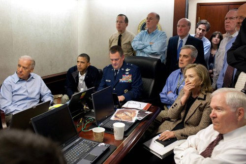 U.S. President Barack Obama (2nd L) and Vice President Joe Biden (L), along with members of the national security team, receive an update on the mission against Osama bin Laden in the Situation Room of the White House, May 1, 2011. Also pictured are Secretary of State Hillary Clinton (2nd R) and Defense Secretary Robert Gates (R). Please note: A classified document seen in this photograph has been obscured at source. Picture taken May 1, 2011. White House/Pete Souza/Handout