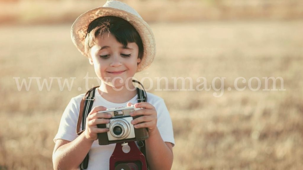 child holding a camera