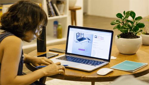 girl searching high-resolution photos on unsplash website