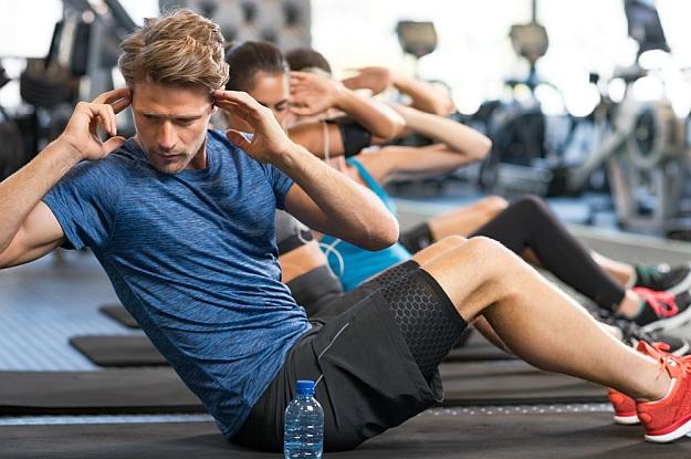 Man making sit ups | Reasons to Love Tyent Water Ionizers, Part 6: Sports