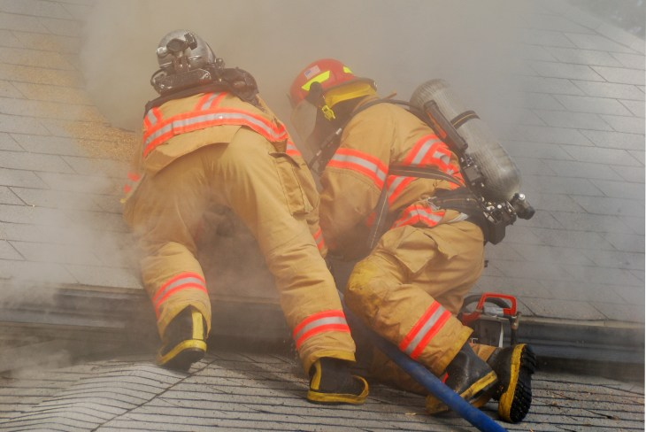 working an active attic fire in a dwelling on fire