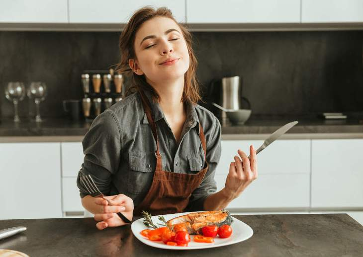 Pretty young woman sitting kitchen   Everything You Need To Know About Healthy Eating