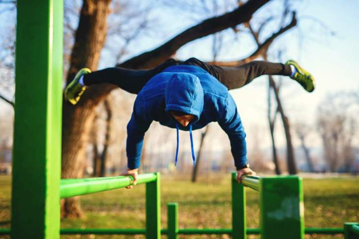 Fit man working out park | Best Quick Workouts For Busy People Who Don't Have Much Time