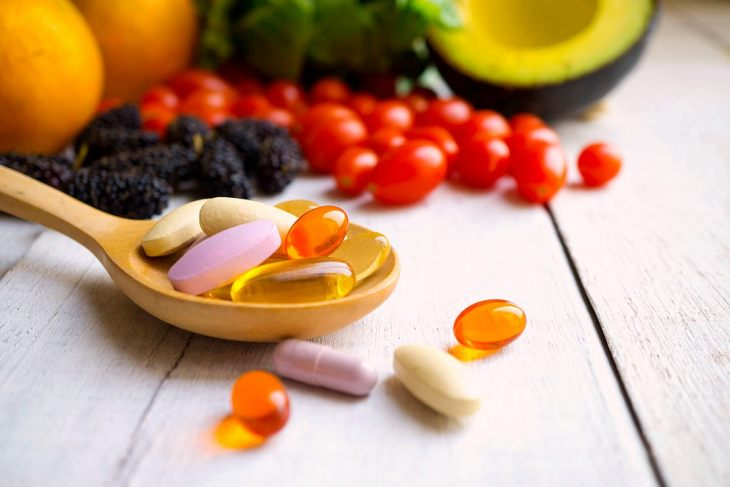 Pills, Capsules with Wooden Spoon and Fresh Fruits | Take Multivitamins | Ways to Restore Your Body's pH Balance