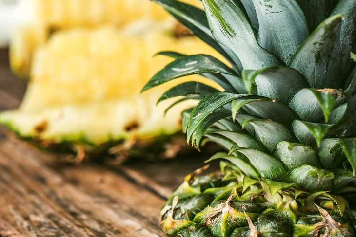 sliced pineapple | High Alkaline Foods To Add To Your Diet
