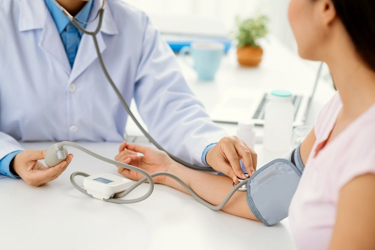 Doctor checking patient blood pressure | Reasons Why Processed Meat Is Bad For Your Health