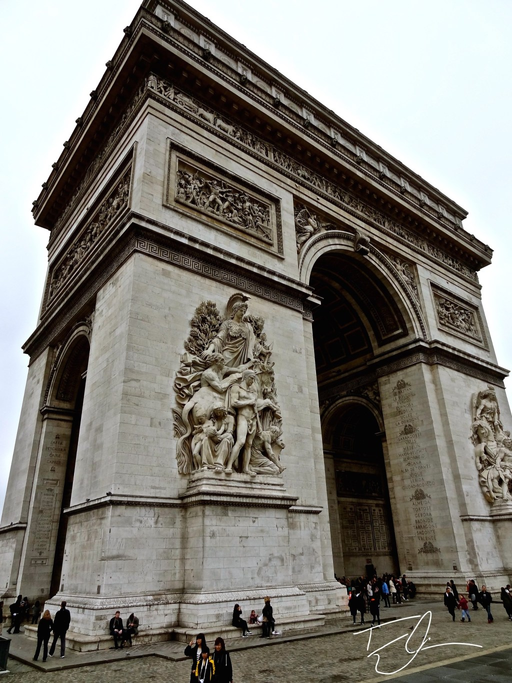 Looking up at the Arc de Triomph in Paris, France