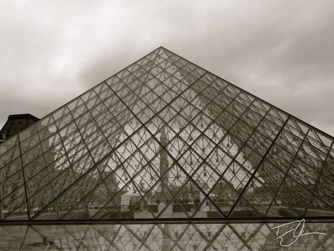 Glass Pyramid of the Louvre black and white in Paris, France