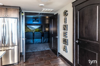 Home theater with Wolf Cinema 4K projection, anamorphic widescreen, Paradigm speakers, Savant automation, 2015 Utah Valley Parade of Homes