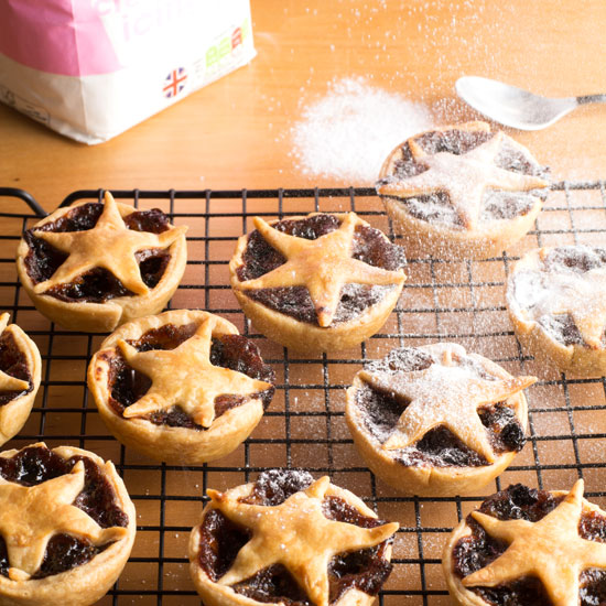 holly-cooks-mince-pies-icing-sugar-in-air550