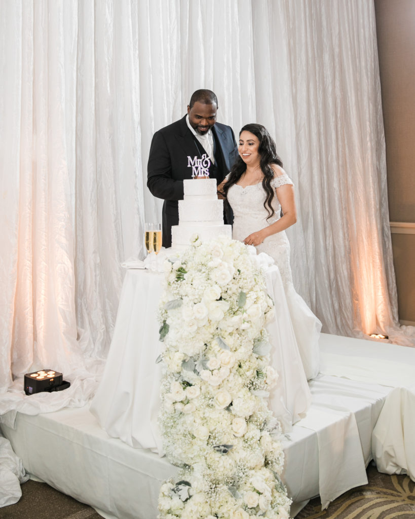 bride and groom cut their cake at their wedding at The Westin San Jose