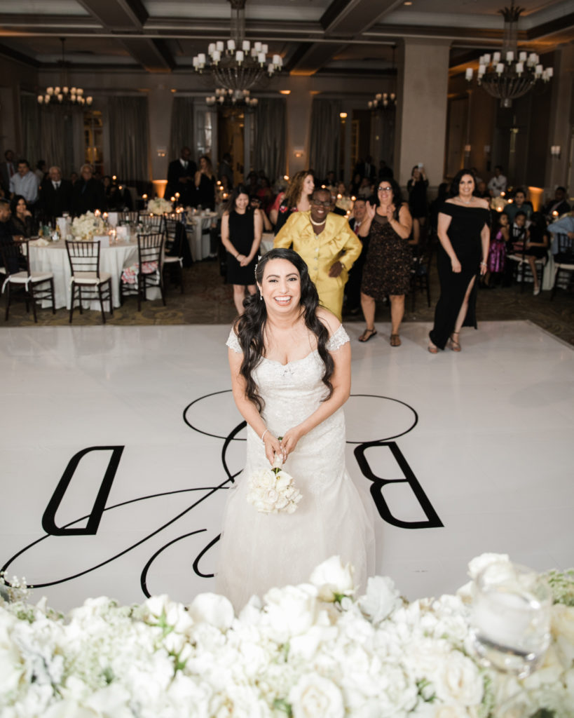 bride throws the bouquet at her wedding at The Westin San Jose