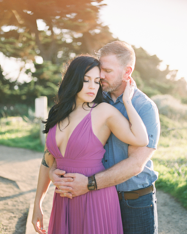 a sexy romantic pose for a couple during their engagement photos at Sutro Baths