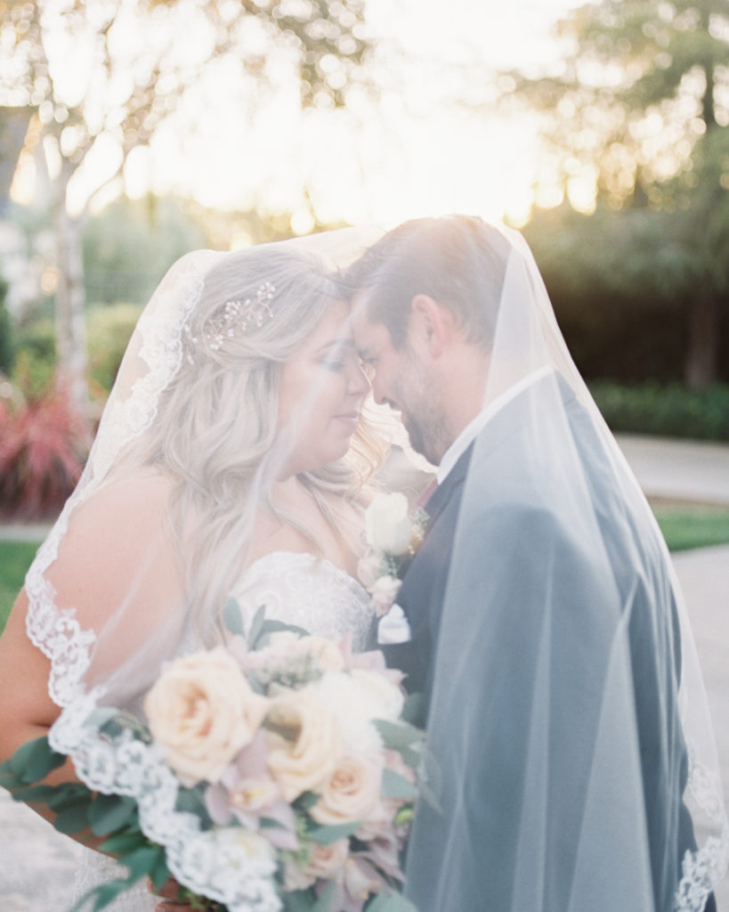 a couple poses together during their intimate estate wedding photos
