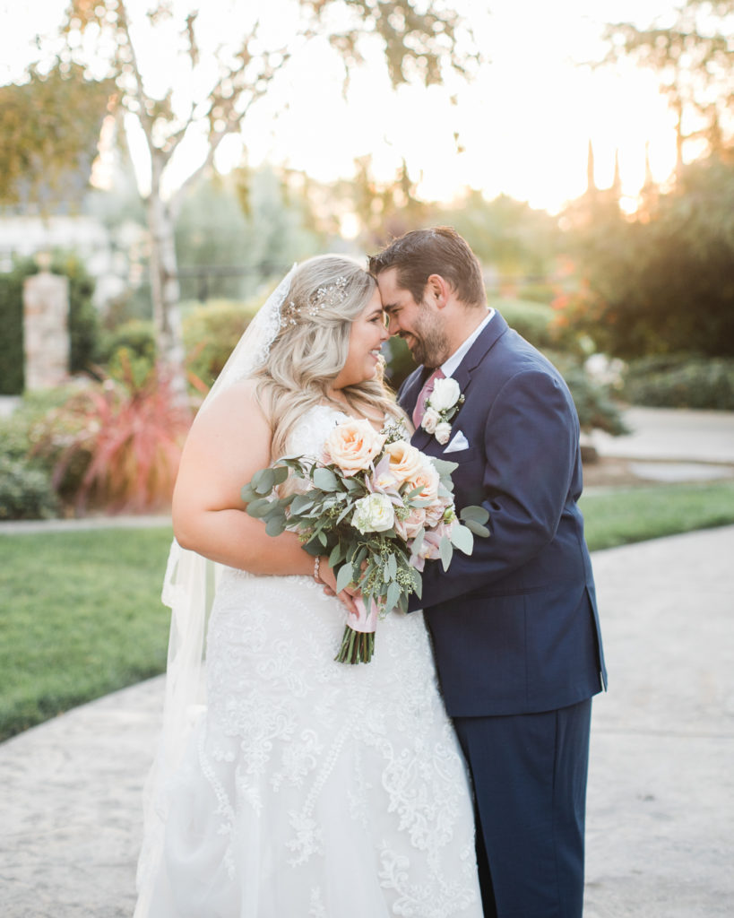golden hour photo of a bride and groom during their intimate estate wedding
