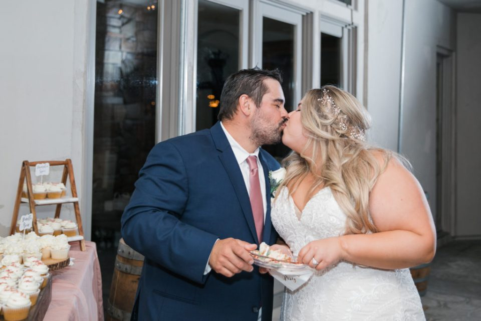 bride and groom cutting the cake during their intimate estate wedding reception
