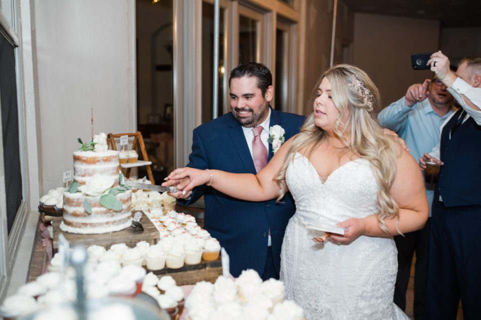 couple cutting the cake at their intimate estate wedding reception