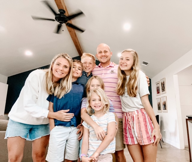 Laura James poses with her family