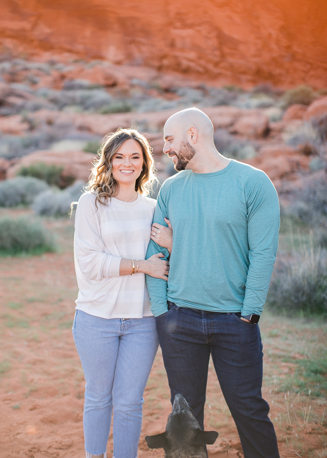 a couple poses for photos during Valley of Fire engagement session