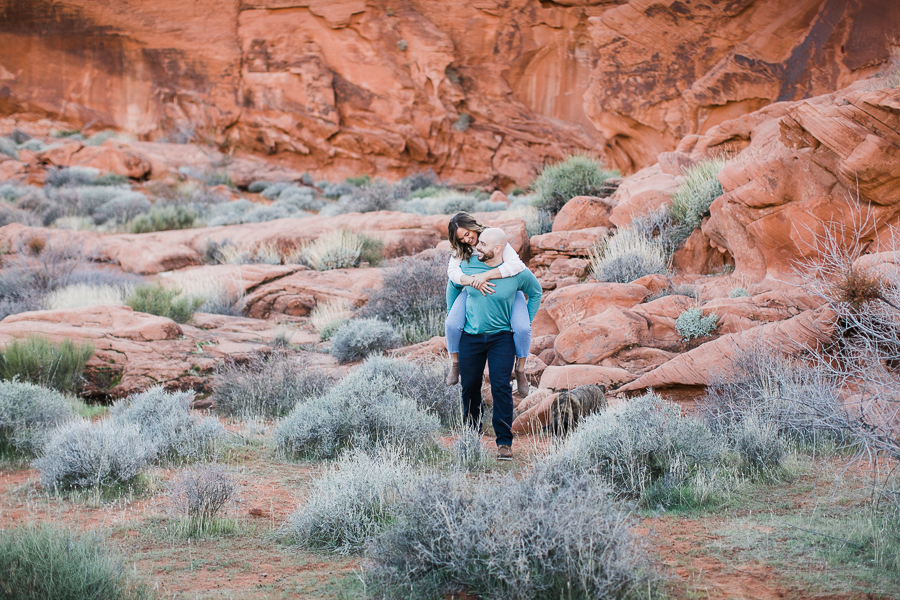 piggyback rides during Valley of Fire engagement session