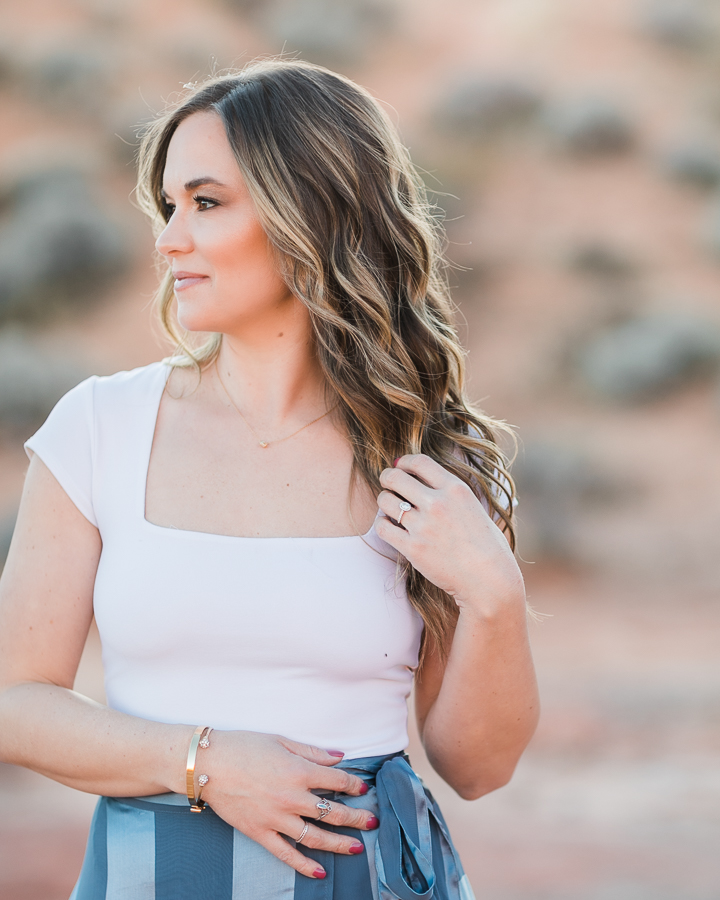 a beautiful woman poses during her Valley of Fire engagement session