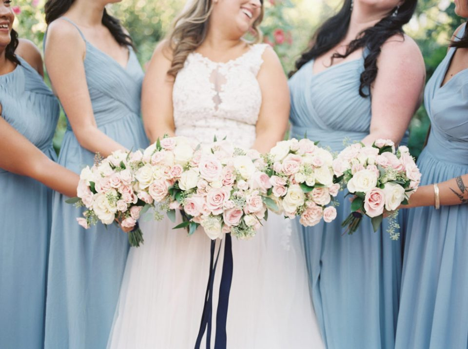 bride and bridesmaids in dusty blue bridesmaids dresses