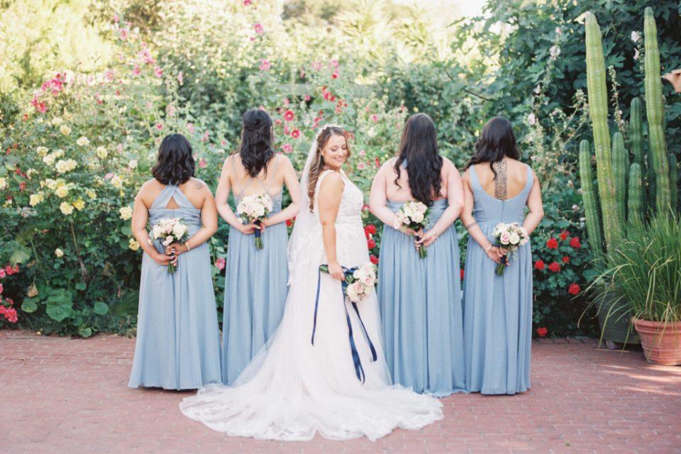 bride and bridesmaids pose for photos before wedding at Jardines de San Juan