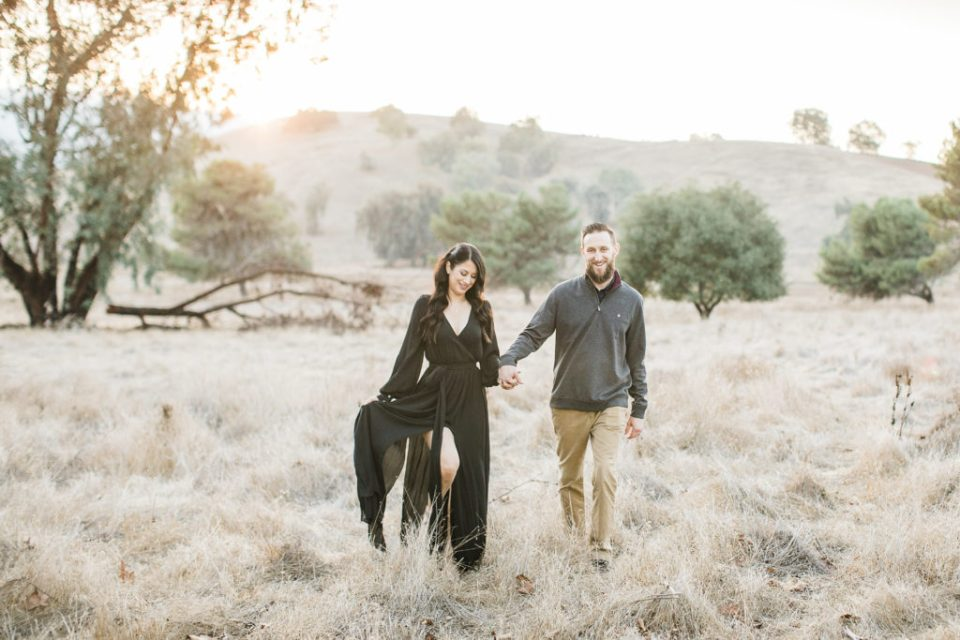 a mother and father walk together during family photos at Santa Teresa Park