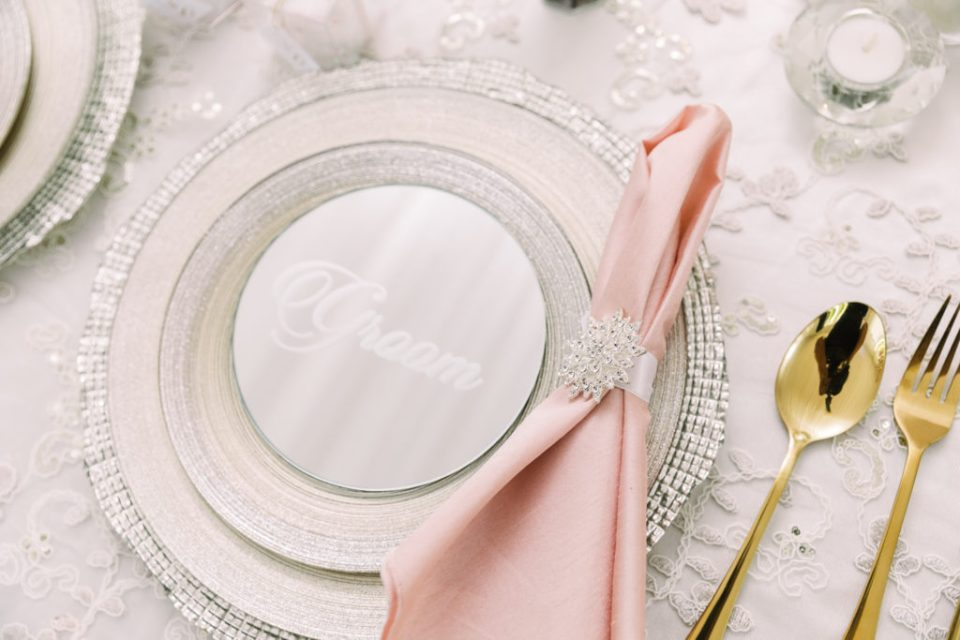 light pink and ivory table settings at a Grand Island Mansion wedding