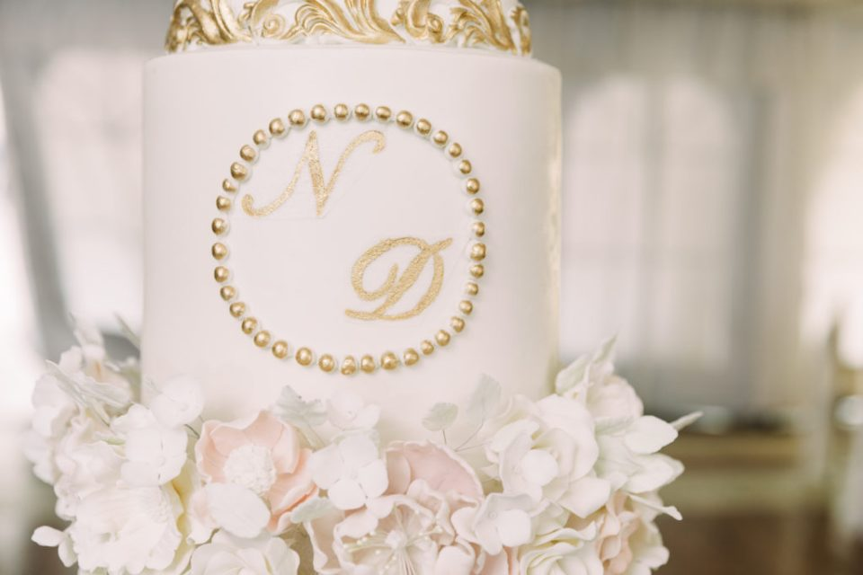 a close up of a towering wedding cake at a Grand Island Mansion wedding