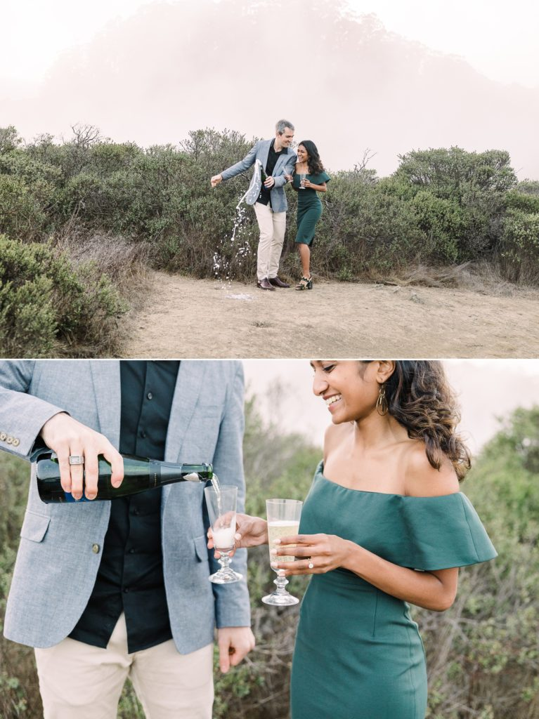 a couple pops a bottle of champagne during their Marin County engagement photos