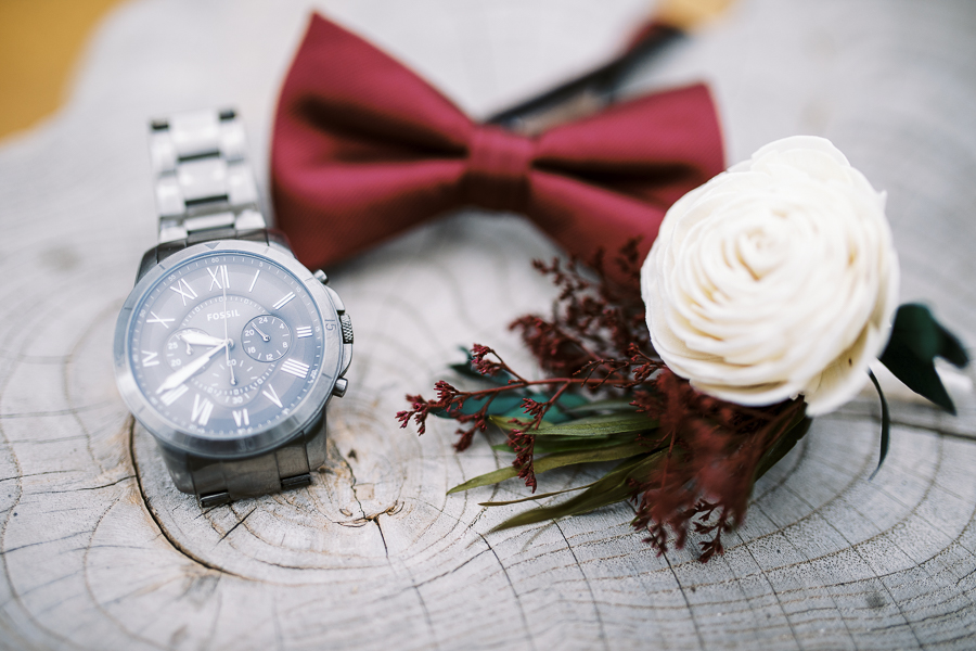 groom's details - watch, bowtie, and boutoinniere - for a Bay Area intimate wedding