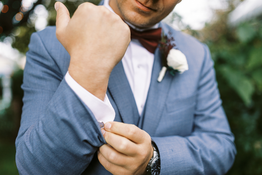 a groom gets dressed for his Bay Area intimate wedding