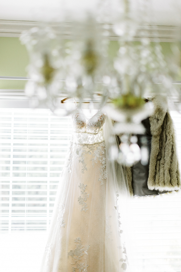 a gorgeous wedding dress and shawl hanging for photos before a Bay Area intimate wedding