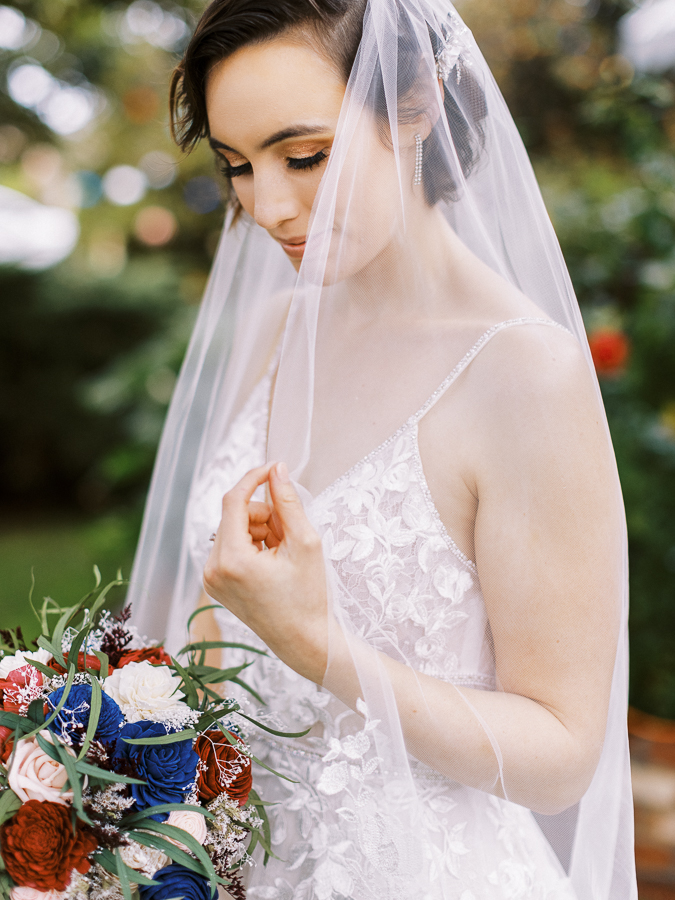 a bride holds onto her veil and bouquet at her Bay Area intimate wedding