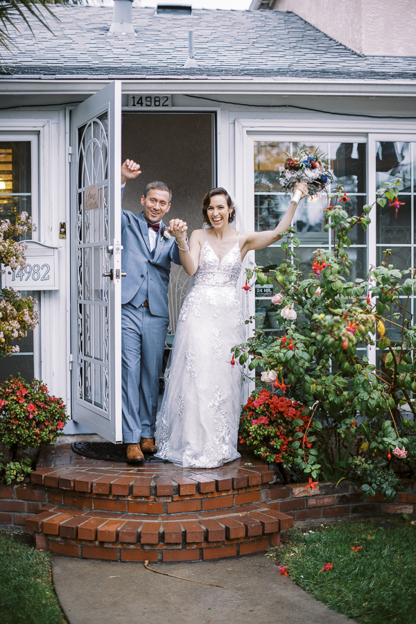 a bride and groom celebrate after their Bay Area intimate wedding ceremony