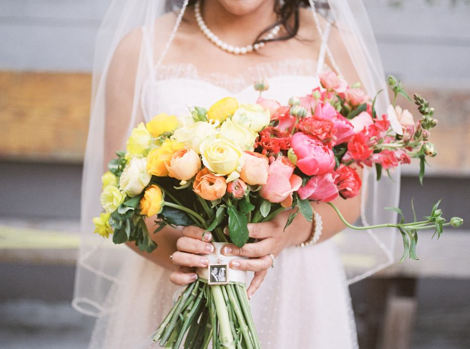 a beautiful pink, yellow, and orange wedding bouquet at Stable Cafe in San Francisco